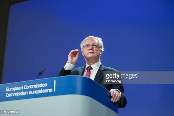 David Davis UK exiting the European Union secretary listens during a news conference following the start of Brexit negotiations in Brussels Belgium...
