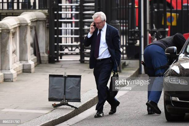 David Davis UK exiting the European Union secretary speaks on a mobile telephone as he arrives for a cabinet meeting at number 10 Downing Street in...