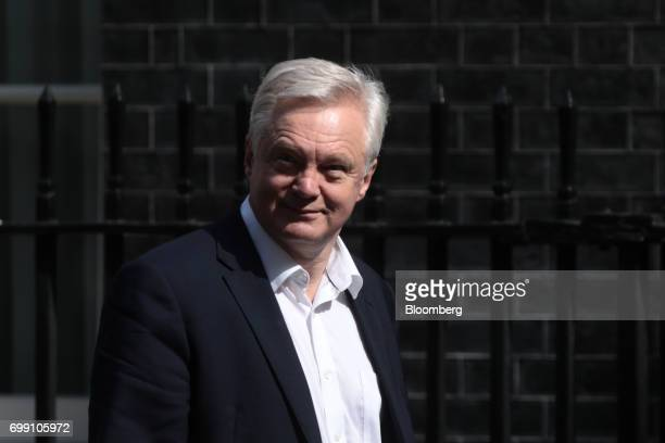 David Davis UK exiting the European Union secretary walks in Downing Street to attend the state opening of Parliament in London UK on Wednesday June...