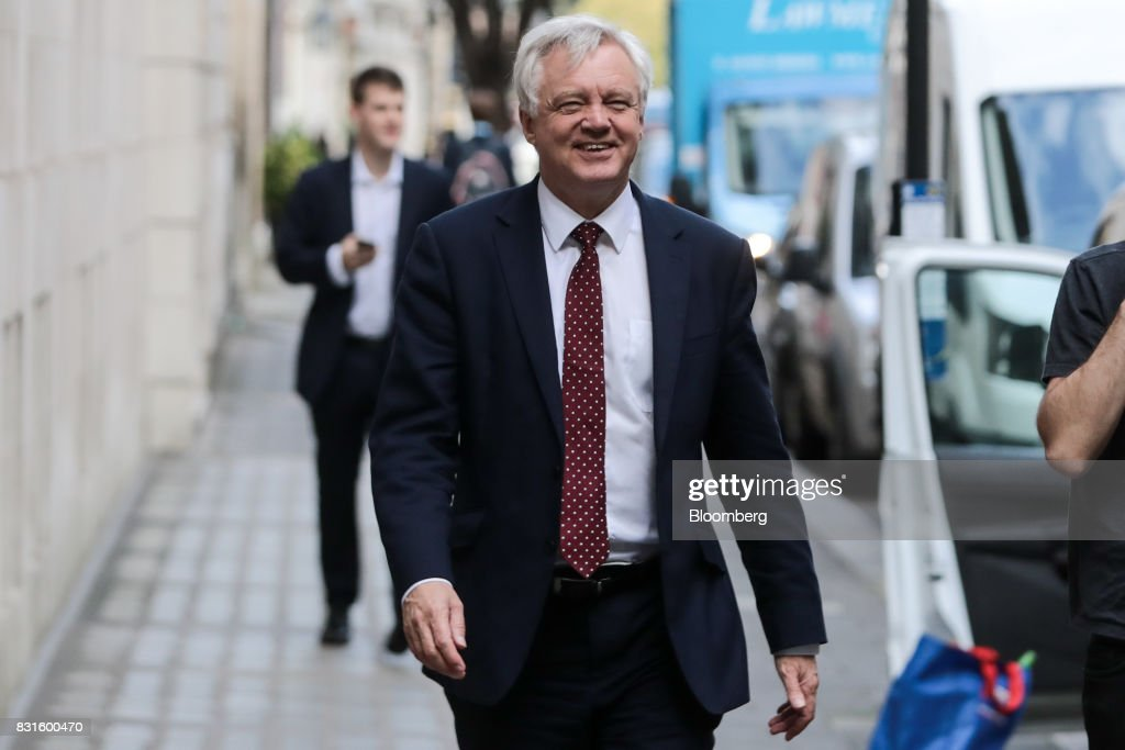 David Davis, U.K. exiting the European Union (EU) secretary, walks in-between doing media interviews in London, U.K., on Tuesday, Aug. 15, 2017. The U.K. government said it wants to maintain tariff-free, bureaucracy-light trade with the European Union for a period of up to two years after Brexit, a proposalcheered by British businesses but which is likely to raise eyebrows on the continent. Photographer: Simon Dawson/Bloomberg via Getty Images