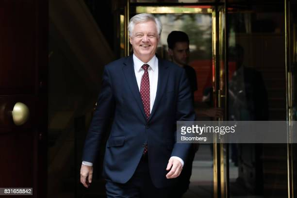David Davis UK exiting the European Union secretary walks inbetween doing media interviews in London UK on Tuesday Aug 15 2017 The UK government said...