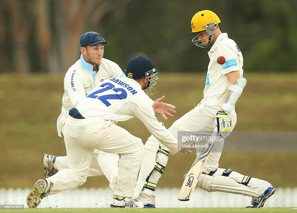 David Dawson and Peter Nevill of the Blues attempt to take the catch of Jason Behrendorff of the Warriors during day four of the Sheffield Shield match between the New South Wales Blues and the Western Australia Warriors at Bankstown Oval on January 27, 2013 in Sydney, Australia.