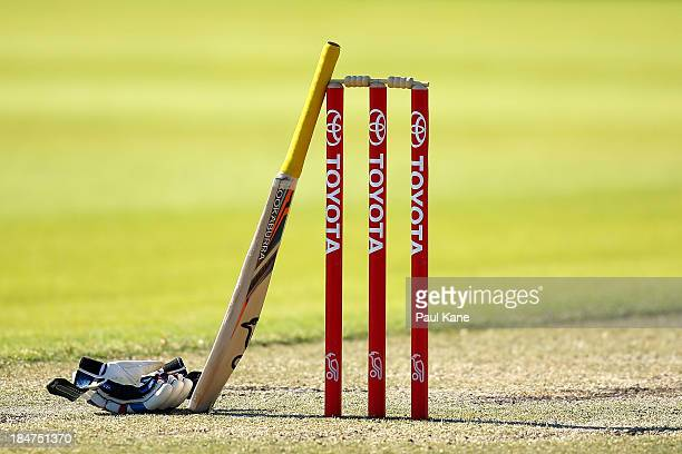 David Dawson of New South Wales rests his bat on the stumps at a drinks break during day three of the Futures League match between Western Australia...