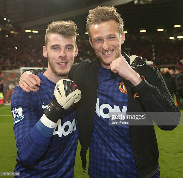 David de Gea and Anders Lindegaard of Manchester United celebrates on the pitch after the Barclays Premier League match between Manchester United and...