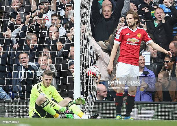 David de Gea and Daley Blind of Manchester United react to conceding a goal to Dele Alli of Tottenham Hotspur during the Barclays Premier League...