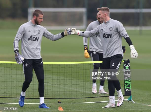 David de Gea and Dean Henderson of Manchester United in action during a first team training session at Aon Training Complex on September 28 2020 in...