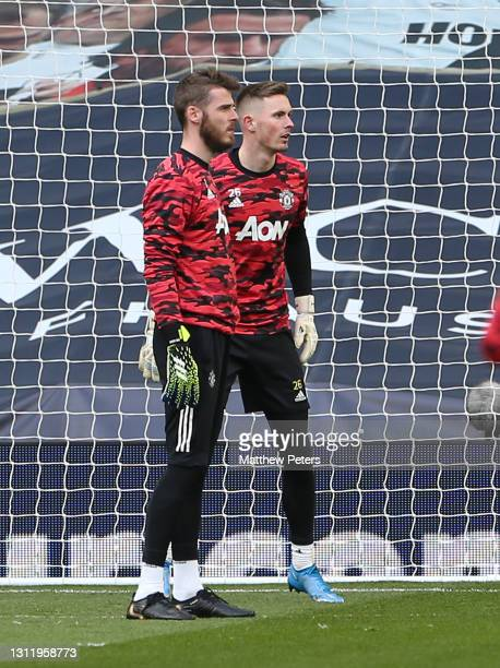 David de Gea and Dean Henderson of Manchester United warm up ahead of the Premier League match between Tottenham Hotspur and Manchester United at...