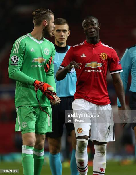 David de Gea and Eric Bailly of Manchester United walk off after the UEFA Champions League group A match between Manchester United and SL Benfica at...