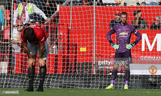 David de Gea and Harry Maguire of Manchester United react to conceding a goal to Patrick van Aanholt of Crystal Palace during the Premier League...