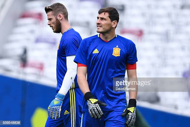 David de Gea and Iker Casillas of Spain during a training session ahead of their UEFA Euro 2016 Group D match at the Stadium Municipal on June 11...