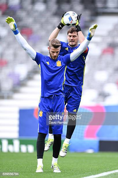David de Gea and Iker Casillas of Spain in action during a training sesion ahead of their UEFA Euro 2016 Group D match at the Stadium Municipal on...