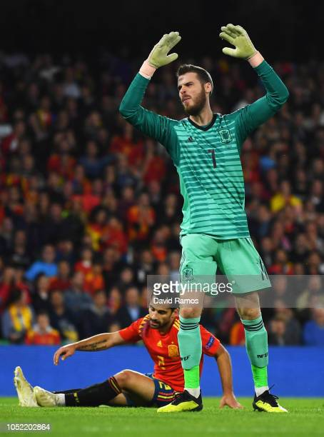 David de Gea and Jonny of Spain react as Marcus Rashford of England scores his team's second goal during the UEFA Nations League A Group Four match...