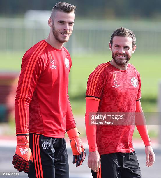David de Gea and Juan Mata of Manchester United in action during a first team training session at Aon Training Complex on September 29 2015 in...