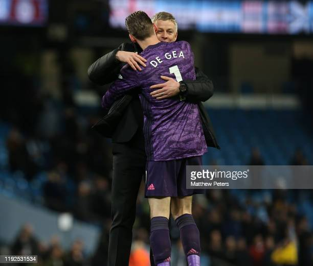David de Gea and Manager Ole Gunnar Solskjaer of Manchester United celebrates after the Premier League match between Manchester City and Manchester...