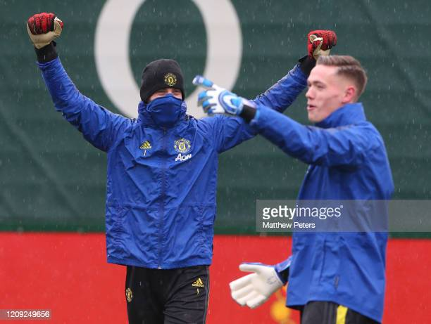 David de Gea and Nathan Bishop of Manchester United in action during a first team training session at Aon Training Complex on February 28 2020 in...
