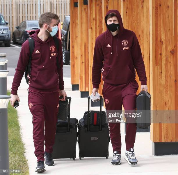 David de Gea and Victor Lindelof of Manchester United checks in ahead of their flight to Granada at Manchester Airport on April 07, 2021 in...
