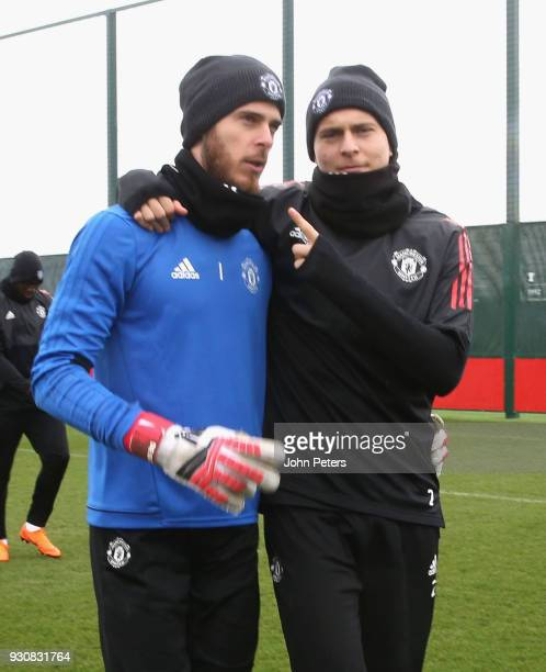 David de Gea and Victor Lindelof of Manchester United in action during a first team training session at Aon Training Complex on March 12 2018 in...