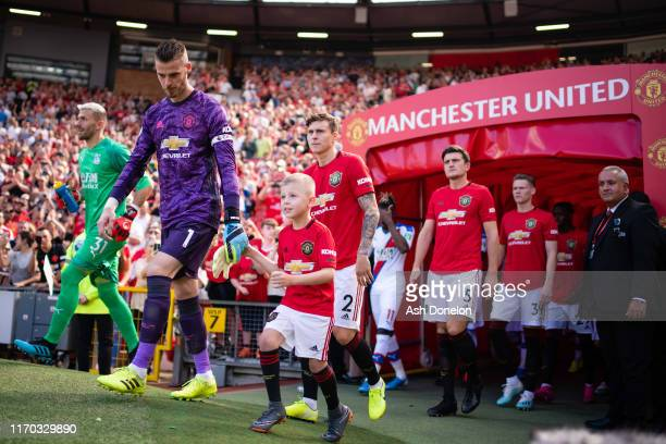 David de Gea and Victor Lindelof of Manchester United walk out ahead of the Premier League match between Manchester United and Crystal Palace at Old...