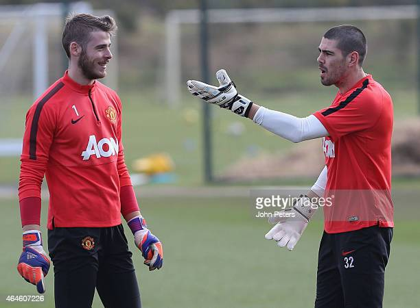David de Gea and Victor Valdes of Manchester United in action during a first team training session at Aon Training Complex on February 27 2015 in...