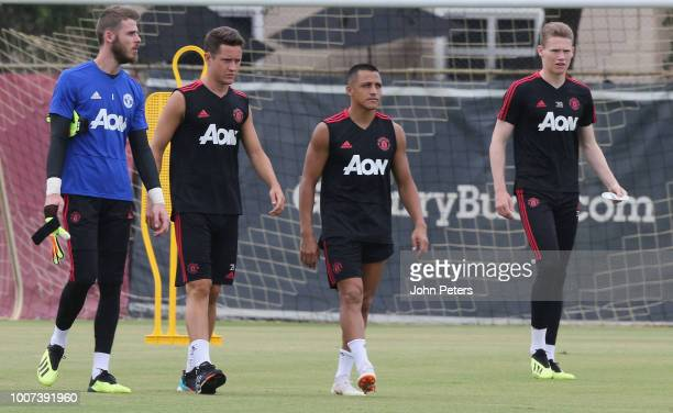 David de Gea Ander Herrera Alexis Sanchez and Scott McTominay of Manchester United in action during a first team training session as part of their...