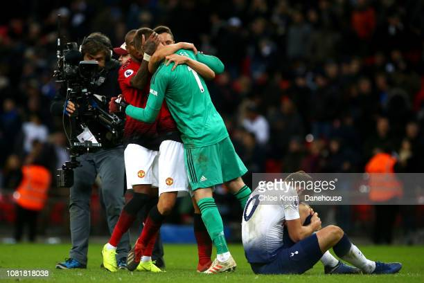 David De Gea Ashley Young and Luke Shaw of Manchester United celebrate winning while Harry Kane of Tottenham Hotspur holds his leg in pain during the...