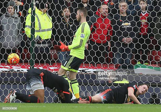 David de Gea Chris Smalling and Phil Jones of Manchester United react to Marko Arnautovic of Stoke City scoring their second goal during the Barclays...