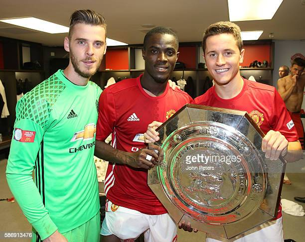 David de Gea, Eric Bailly and Ander Herrera of Manchester United pose with the Community Shield trophy in the dressing room after the FA Community...