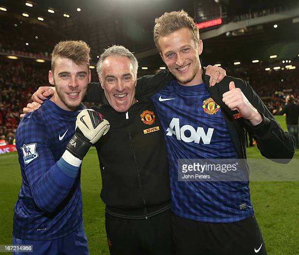 David de Gea goalkeeping coach Eric Steele and Anders Lindegaard of Manchester United celebrates on the pitch after the Barclays Premier League match...