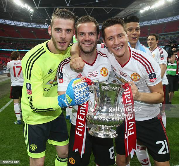 David de Gea Juan Mata and Ander Herrera of Manchester United celebrate after The Emirates FA Cup final match between Manchester United and Crystal...
