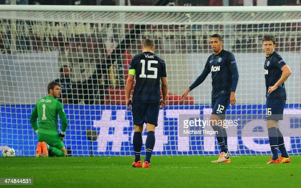 David De Gea, Nemanja Vidic, Chris Smalling and Michael Carrick of Manchester United react after conceding the first goal during the UEFA Champions...