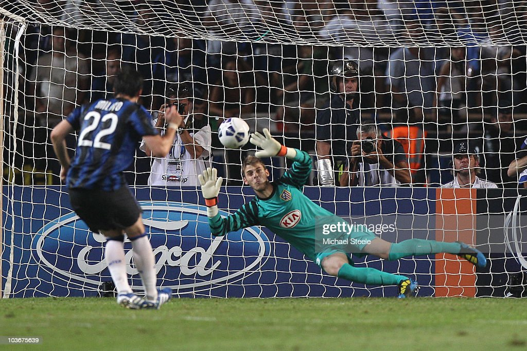 David de Gea of Atletico saves a penalty from Diego Milito of Inter during the UEFA Super Cup match between Inter Milan and Atletico Madrid at Louis II Stadium on August 27, 2010 in Monaco, Monaco.