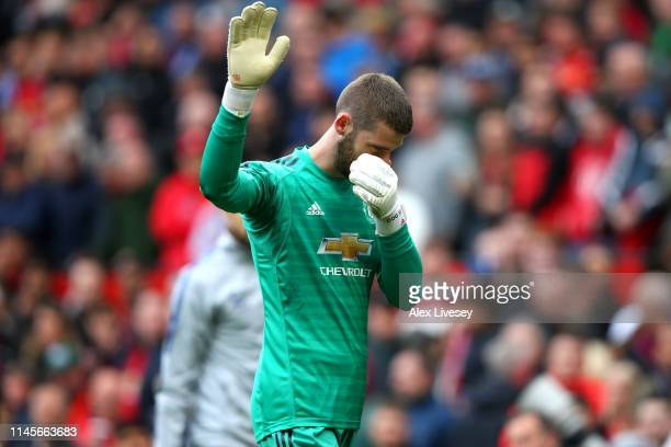David De Gea of Manchester United acknowledges the fans as he looks dejected at half time during the Premier League match between Manchester United...