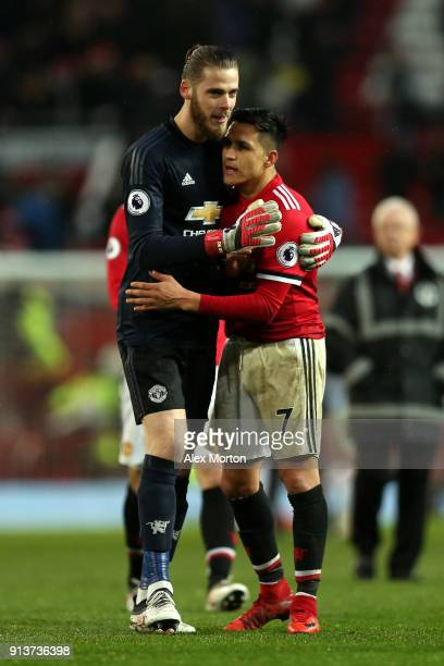 David De Gea of Manchester United and Alexis Sanchez of Manchester United embrace after the Premier League match between Manchester United and...