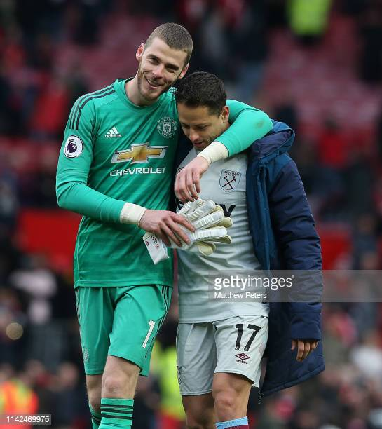 David de Gea of Manchester United and Chicharito of West Ham United walk off after the Premier League match between Manchester United and West Ham...