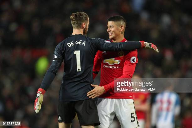 David de Gea of Manchester United and Marcos Rojo of Manchester United celebrate at full time during the Premier League match between Manchester...