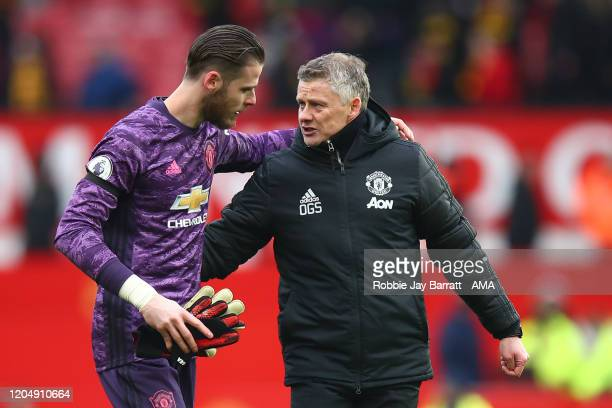 David de Gea of Manchester United and Ole Gunnar Solskjaer the head coach / manager of Manchester United during the Premier League match between...