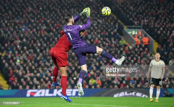 David De Gea of Manchester United attempts to collect the ball as he is challenged by Virgil van Dijk of Liverpool during the Premier League match...