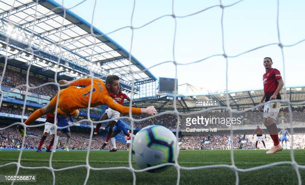 David De Gea of Manchester United attempts to save a header from Antonio Ruediger of Chelsea but fails and Chelsea score their first goal during the...
