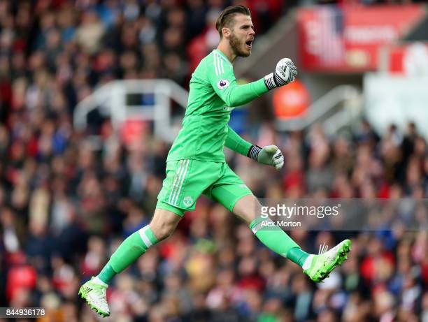 David De Gea of Manchester United celebrates after his side score their second goal during the Premier League match between Stoke City and Manchester...