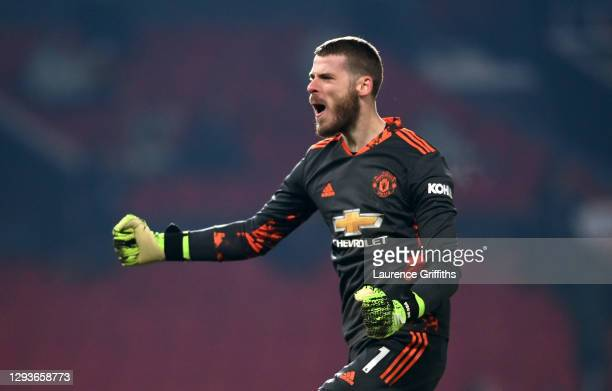 David De Gea of Manchester United celebrates after his team's first goal scored by teammate Marcus Rashford during the Premier League match between...