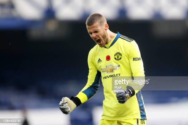 David De Gea of Manchester United celebrates after his team's third goal during the Premier League match between Everton and Manchester United at...