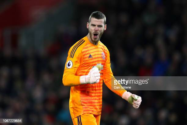 David De Gea of Manchester United celebrates after teammate Ander Herrera scores their team's second goal during the Premier League match between...