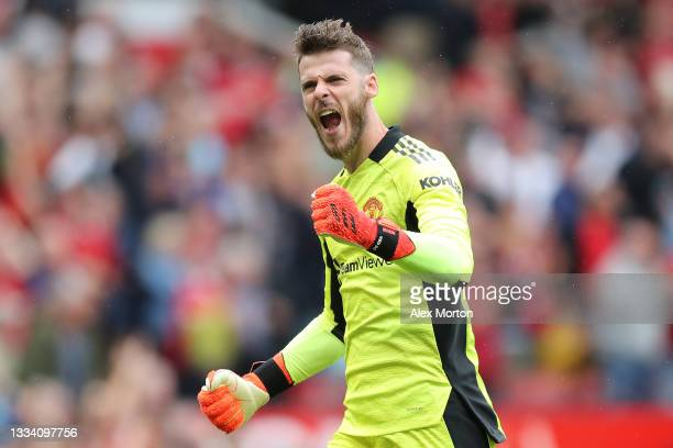 David de Gea of Manchester United celebrates after their side's third goal scored by Bruno Fernandes during the Premier League match between...