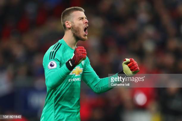 David De Gea of Manchester United celebrates as Marcus Rashford of Manchester United scores his team's first goal during the Premier League match...