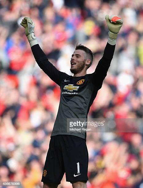 David De Gea of Manchester United celebrates at the end of the Barclays Premier League match between Manchester United and Everton at Old Trafford on...
