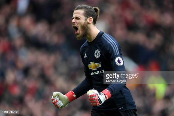 David De Gea of Manchester United celebrates his side's first goal during the Premier League match between Manchester United and Liverpool at Old...