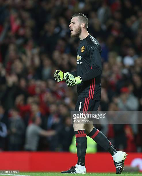 David de Gea of Manchester United celebrates Juan Mata scoring their first goal during the EFL Cup Fourth Round match between Manchester United and...