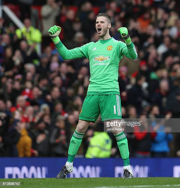David de Gea of Manchester United celebrates Marcus Rashford scoring their first goal during the Barclays Premier League match between Manchester...