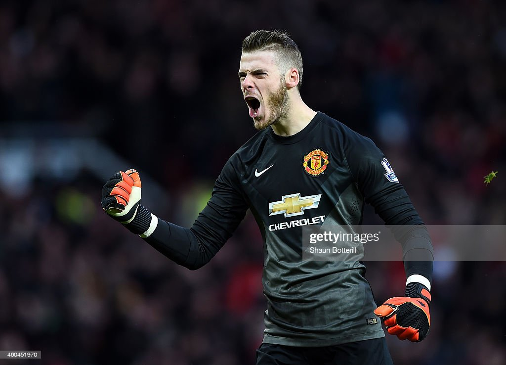 David De Gea of Manchester United celebrates the first goal during the Barclays Premier League match between Manchester United and Liverpool at Old Trafford on December 14, 2014 in Manchester, England.