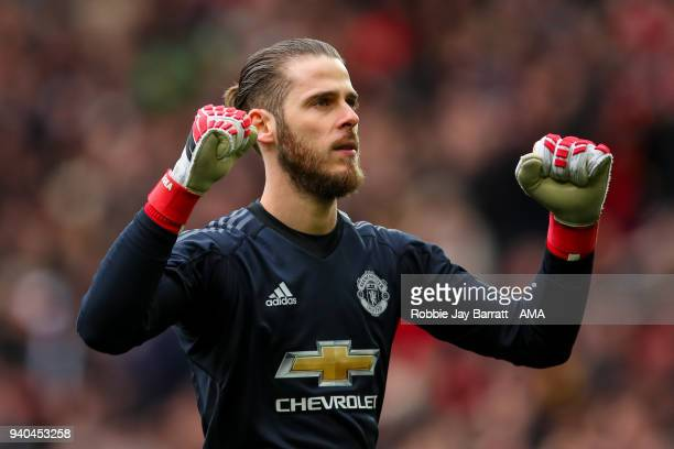 David de Gea of Manchester United celebrates the first goal during the Premier League match between Manchester United and Swansea City at Old...